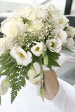 Wedding bouquet in woman hand. The white wedding bouquet in woman hand Royalty Free Stock Photos