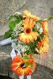 Wedding bouquet on wood. Orange wedding bouquet on wood Royalty Free Stock Images