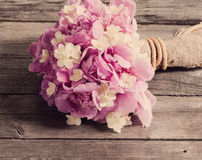 Wedding bouquet on wooden background Royalty Free Stock Photography