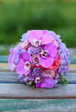 Wedding bouquet on a wooden bank Royalty Free Stock Image
