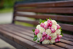 Wedding bouquet on wooden bench Royalty Free Stock Photo