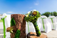 Wedding bouquet. Beside a wooden decoration Stock Image