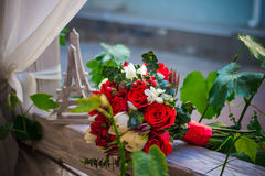 Wedding bouquet on a wooden porch with a figure of the Eiffel Tower Stock Images