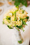 Wedding bouquet in yellow. On a table Stock Images