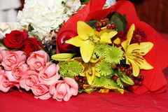Wedding bouquet. Yellow pink and red roses and other flowersin wedding bouquet Stock Image