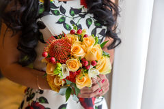 Wedding bouquet of yellow roses. the bride holding a bouquet of yellow roses Stock Photo