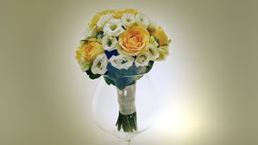 A wedding bouquet of yellow roses, eustoma and eucalyptus greens.. Bouquet in rotation. stock footage