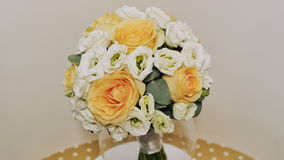 A wedding bouquet of yellow roses, eustoma and eucalyptus greens.. Bouquet in rotation. stock video