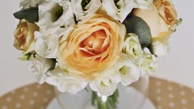 A wedding bouquet of yellow roses, eustoma and eucalyptus greens. Bouquet in rotation. stock video footage