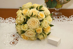 Wedding bouquet. Yellow roses on the table Stock Photos