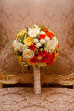 Wedding bouquete on chair. With white roses royalty free stock images