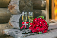Wedding bouquete and glasses of champagne Stock Image