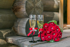 Wedding bouquete and glasses of champagne Stock Images