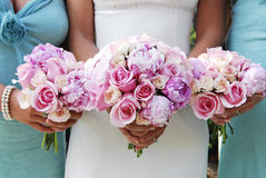 Wedding Bouquets. The bride and her bridesmaids, focus on the flower bouquets Stock Photography
