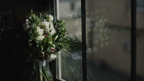 bridal bouquet of fresh flowers at the window stock video footage