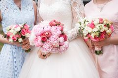 Wedding bouquets at the bride and bridesmaids stock image
