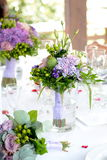 Wedding bouquets. Wedding flower bouquets set in vases on a table Royalty Free Stock Photo