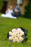 Wedding bouquets on the grass. Wedding bouquet on grass in castle garden Royalty Free Stock Photos