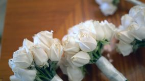 Wedding bouquets on a table. Roses color white