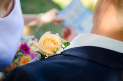 Wedding boutonniere on a costume of groom Stock Images