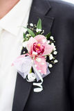 Wedding boutonniere in his lapel black men wedding suit. Wedding in the winter cold day Stock Photography