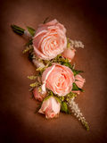 Wedding boutonniere of roses on a background of brown kraft paper Stock Photo