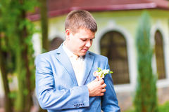 Wedding boutonniere on suit of groom Royalty Free Stock Images
