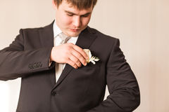 Wedding boutonniere on suit of groom Stock Images