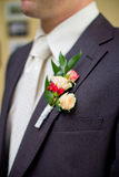 Wedding boutonniere on suit Stock Images