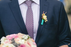 Wedding boutonniere on suit Stock Photo
