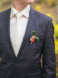 Wedding boutonniere on suit Royalty Free Stock Photo