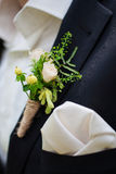 Wedding boutonniere. On a suit and a scarf groom royalty free stock photography