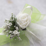 Wedding boutonniere on table Royalty Free Stock Photos
