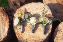 Wedding boutonniere on wooden spilite Royalty Free Stock Image