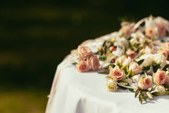 Wedding boutonnieres for quests on table with place for sign. Outdoor stock photos