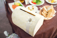 Wedding box on banquet table Royalty Free Stock Photos