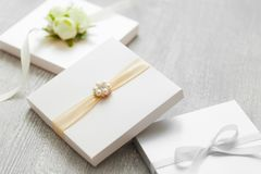 Wedding boxes for gifts or invitation cards. Wedding boxes for gifts or invitation cards on gray wooden table Stock Photography