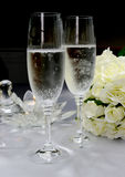 Wedding breakfast dining table setting with champagne glasses. Royalty Free Stock Photography