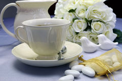 Wedding breakfast dining table setting with fine china coffee cup and milk jug - horizontal. Royalty Free Stock Photography