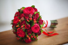 Wedding bridal bouquet of big red roses. Beautiful wedding bridal bouquet of big red roses Stock Photos