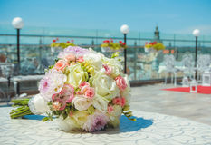 Wedding Bridal bouquet - colorful flowers, pink, White roses and yellow freesia, lying on the table at the wedding. Stock Images