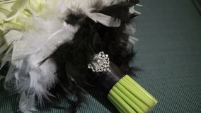 Wedding bridal bouquet on green sofa. Wedding bridal bouquet with feathers on green sofa stock video