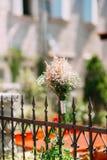 Wedding bridal bouquet of Gypsophila on a metal fence. Wedding i Stock Images