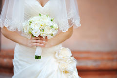 Wedding bridal bouquet in the hands of ivory color.  royalty free stock image