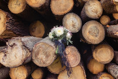Wedding bridal bouquet in the logs Stock Photography