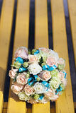 Wedding bridal bouquet lying on  park bench. Stock Image