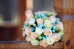 Wedding bridal bouquet lying on  park bench. Royalty Free Stock Photos