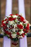 Wedding bridal bouquet lying on  park bench. Royalty Free Stock Images