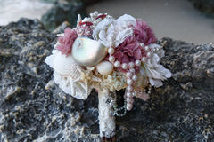 Wedding bridal bouquet made ​​of shells and pearls and other Stock Photography