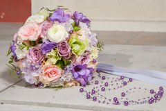 Wedding bridal bouquet with purple beads Royalty Free Stock Images